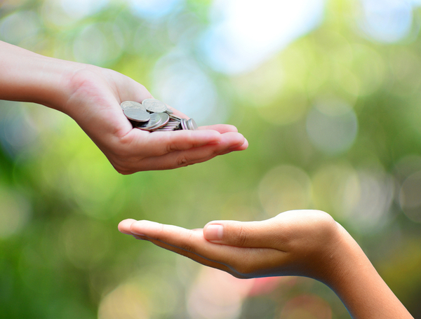 Money on hand philanthropy concept give donate charity finance and grant