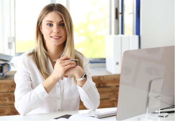 Beautiful smiling businesswoman portrait at workplace look in camera