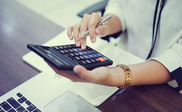 Close up on senior accountant woman hand press on calculator for computing