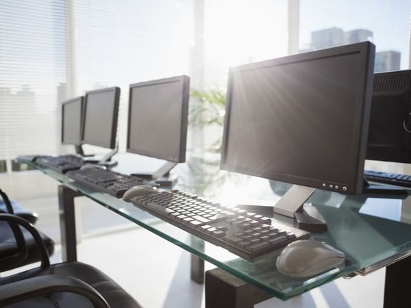 Composite image of computer in front of window in office
