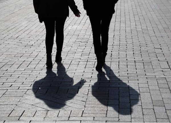 Silhouette shadows of two walking women