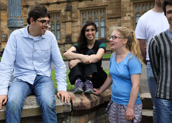 Young people happily talking and relaxing