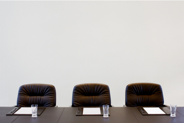 Three chairs inside a board room