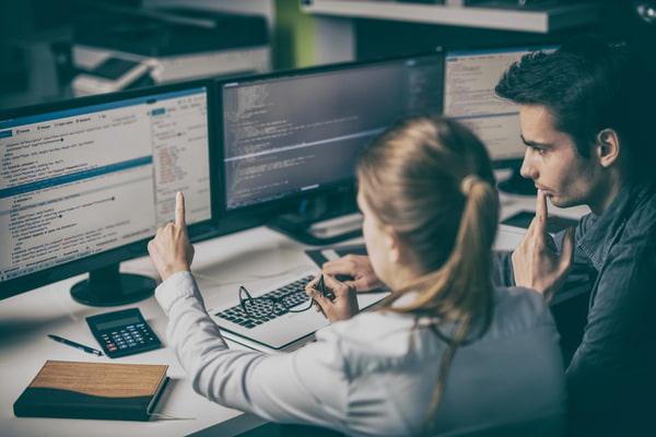 Man and woman programming and coding technologies