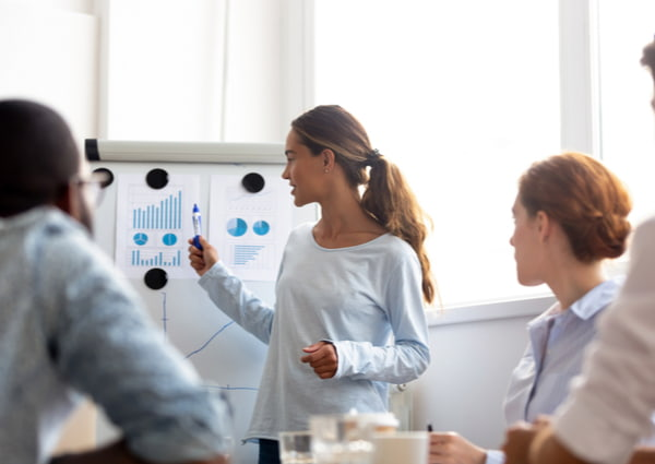 Woman give business presentation at office conference meeting