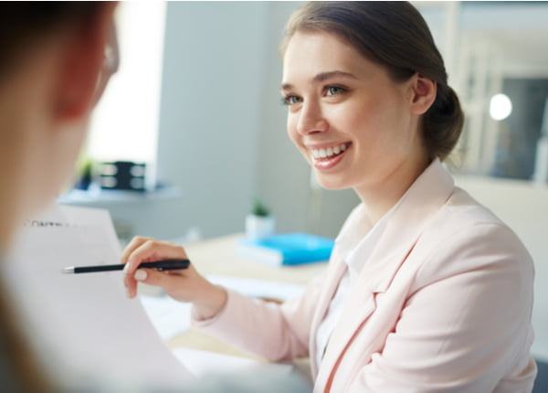 Accountant pointing at financial document in her hand