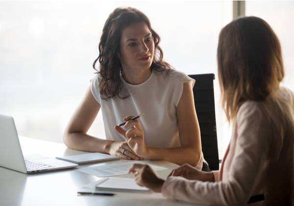 Two businesswomen discussing business project