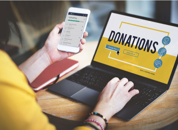 Woman using a laptop checking the Donation site