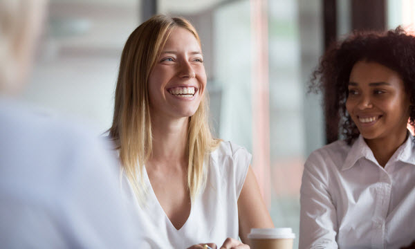 Happy woman talking to her colleagues