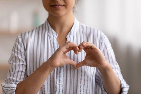 Woman formed a heart shape using her hands