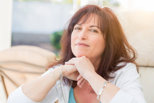 Middle aged woman smiling to the camera