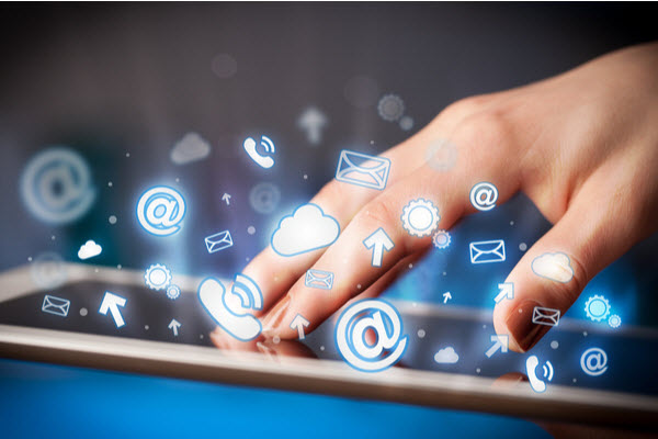 Hand of a woman, touching the screen of a tablet with social media icons