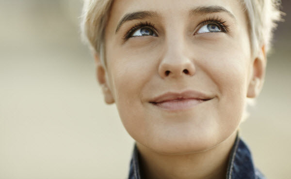 Woman thinking of happy thoughts