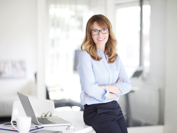 Businesswoman standing at her office