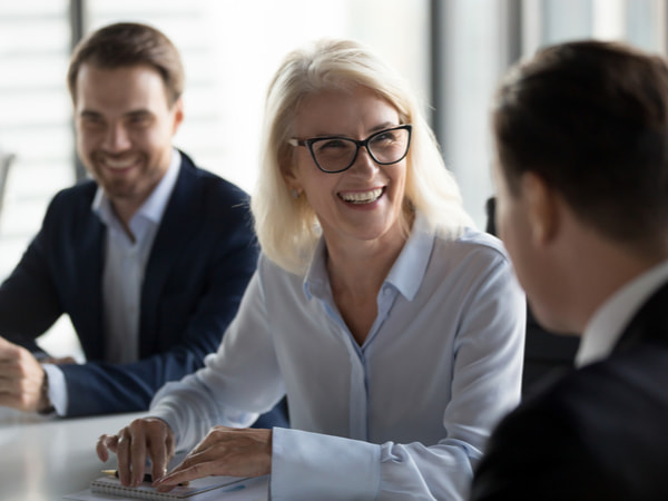Businesswoman enjoying fun conversation with partner